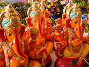 """29 SEPTEMBER 2012 - NAKORN NAYOK, THAILAND:   Statues of Ganesh at Ganesh Ustav celebrations at Wat Utthayan Ganesh, a temple dedicated to Ganesh in Nakorn Nayok, about three hours from Bangkok. Many Thai Buddhists incorporate Hindu elements, including worship of Ganesh into their spiritual life. Ganesha Chaturthi also known as Vinayaka Chaturthi, is the Hindu festival celebrated on the day of the re-birth of Lord Ganesha, the son of Shiva and Parvati. The festival, also known as Ganeshotsav (""""festival of Ganesha"""") is observed in the Hindu calendar month of Bhaadrapada, starting on the the fourth day of the waxing moon. The festival lasts for 10 days, ending on the fourteenth day of the waxing moon. Outside India, it is celebrated widely in Nepal and by Hindus in the United States, Canada, Mauritius, Singapore, Thailand, Cambodia, Burma , Fiji and Trinidad & Tobago.    PHOTO BY JACK KURTZ"""