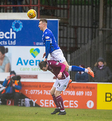 Queen of the South's David Devine over Arbroath's Craig Wighton. Arbroath 2 v 0 Queen of the South, Scottish Championship game played 15/2/2020 at Arbroath's home ground, Gayfield Park.