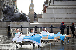 © licensed to London News Pictures. London, UK 25/02/2014. Trafalgar Square is turned into a mock hospital ward to encourage Londoners to volunteer at their local health and care services and to mark the NHS Change Day, a national day of action urging people to pledge to make one positive change to make the NHS better. Photo credit: Tolga Akmen/LNP