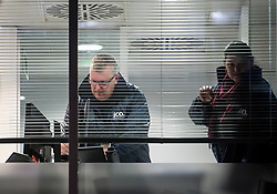 © Licensed to London News Pictures. 23/03/2018. London, UK. Officials from the Information Commissioner's Office (ICO) are seen looking at a computer inside the London headquarters of data firm Cambridge Analytica after a warrant was granted to search the property. The ICO have just been granted a warrant to allow them to search the office. Cambridge Analytica has been implicated in an investigation into the misuse of Facebook user data to influence the outcome of elections. Photo credit: Ben Cawthra/LNP