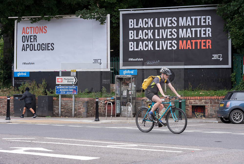 """© Licensed to London News Pictures; 15/07/2020; Bristol, UK. #WhoseFuture campaign outdoor art. Two billboards saying """"Actions over Apologies"""" and """"Black Lives Matter"""" are seen in Bristol as part of a month long arts exhibition starting this week called """"Whose Future"""" by Rising Arts Agency. The month-long outdoor art exhibition is using spaces normally given over to adverts across the city. The work by dozens of young Bristol artists aims to provide a platform for new voices while also asking questions about Bristol's future, and as a response to the ongoing Black Lives Matter campaign, as well as inequalities suffered by young people and the impact on them from the wider Covid-19 lockdown. Bristol hit world headlines when the statue of slave trader Edward Colston was pulled down with ropes and thrown into Bristol docks on 07 June during an All Black Lives/Black Lives Matter protest. Today a new sculpture titled """"A Surge of Power (Jen Reid) 2020"""" by artist Marc Quinn made of black resin and steel was put up on the plinth where the statue of Colston previously stood without any permission from Bristol City council. Jen Reid stood on the empty plinth at the previous protest on 07 June which was in protest for the memory of George Floyd, a black man who was killed on May 25, 2020 in Minneapolis in the US by a white police officer kneeling on his neck for nearly 9 minutes. The killing of George Floyd has seen widespread protests in the US, the UK and other countries. Photo credit: Simon Chapman/LNP."""