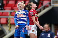 Reading midfielder Jess Fishlock (8) wins a header during the FA Women's Super League match between Manchester United Women and Reading LFC at Leigh Sports Village, Leigh, United Kingdom on 7 February 2021.