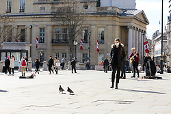 © Licensed to London News Pictures. 16/03/2020. London, UK. Woman wearing a face mask outside nearly empty National Gallery as tourist are avoiding crowded area. 35 coronavirus victims have died and 1,372 have tested positive for the virus in the UK as of 9am on Sunday, 15 March 2020. Photo credit: Dinendra Haria/LNP