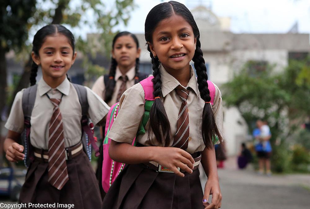 Sri Ram Ashram's Preeeti Sharan, Madu Sharan and Vandana Sharan head to school.<br /> Photo by Shmuel Thaler <br /> shmuel_thaler@yahoo.com www.shmuelthaler.com