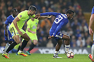 Michy Batshuayi of Chelsea shields the ball from Ryan Tafazolli of Peterborough United. The Emirates FA cup, 3rd round match, Chelsea v Peterborough Utd at Stamford Bridge in London on Sunday 8th January 2017.<br /> pic by John Patrick Fletcher, Andrew Orchard sports photography.