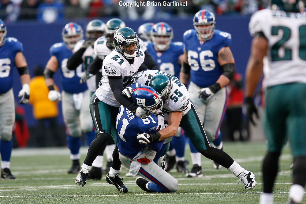 11 Jan 2009: Philadelphia Eagles linebacker Stewart Bradley #55 and cornerback Joselio Hanson #21 tackle New York Giants wide receiver Amani Toomer #81 during the game against the New York Giants on January 11th, 2009.  The  Eagles won 23-11 at Giants Stadium in East Rutherford, New Jersey.