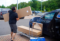 © Licensed to London News Pictures. 01/06/2020. Sheffield , UK. A man loads up in his car at the Ikea store in Sheffield ,South Yorkshire. The furniture and housewares chain reopened some of their stores across England and Northern Ireland  since the lockdown began.  Photo credit: Ioannis Alexopoulos/LNP