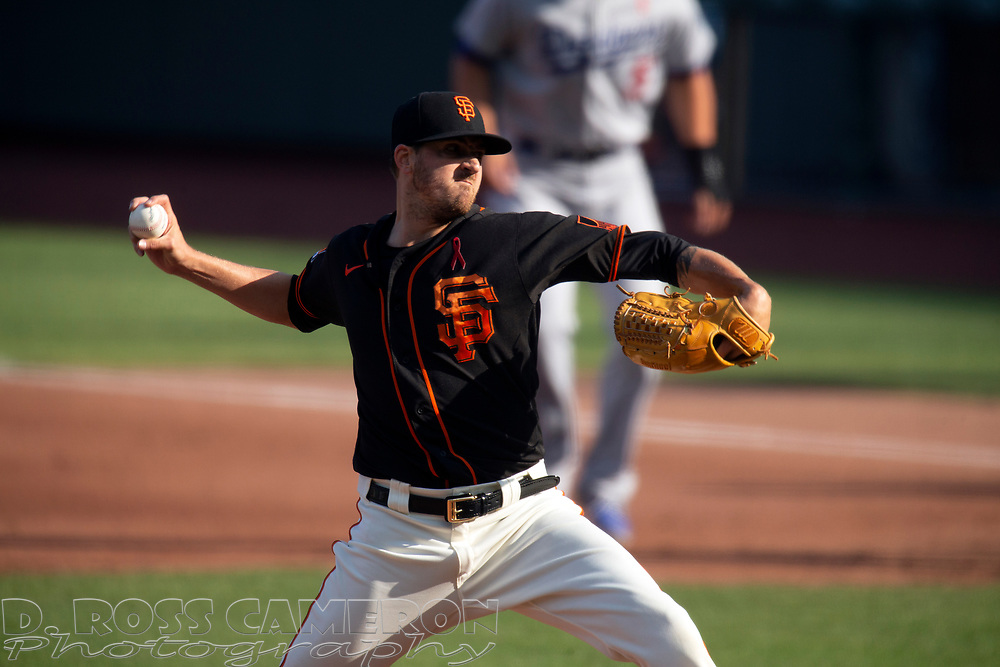 San Francisco Giants starting pitcher Kevin Gausman (34) delivers a pitch against the Los Angeles Dodgers during the third inning of a baseball game on Thursday, Aug. 27, 2020 in San Francisco, Calif. (D. Ross Cameron/SF Chronicle)