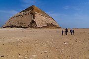 The Bent Pyramid is an ancient Egyptian pyramid located at the royal necropolis of Dahshur, approximately 40 kilometres south of Cairo, built under the Pharaoh Sneferu. This was the second pyramid built by Sneferu.