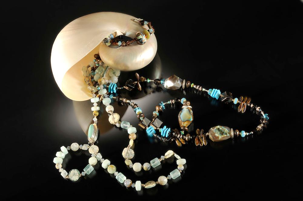 Jewelry around shell.