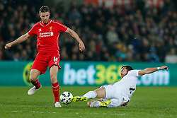 Jordan Henderson of Liverpool is challenged by Jordi Amat of Swansea City before scoring a goal to make it 0-1 - Photo mandatory by-line: Rogan Thomson/JMP - 07966 386802 - 16/03/2015 - SPORT - FOOTBALL - Swansea, Wales — Liberty Stadium - Swansea City v Liverpool - Barclays Premier League.