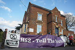 Uxbridge, UK. 1 February, 2020. Environmental activists from Stop HS2, Save the Colne Valley and Extinction Rebellion campaigning against the controversial HS2 high-speed rail link protest outside the constituency office of Boris Johnson in Uxbridge during a 'Still Standing for the Trees' march from the Harvil Road wildlife protection camp in Harefield through Denham Country Park to three addresses closely linked to the Prime Minister in his Uxbridge constituency. Boris Johnson is expected to make a decision imminently as to whether to proceed with the high-speed rail line.