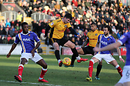 Padraig Amond of Newport county © and Joss Labadie of Newport county (4) get to the ball ahead of Troy Archibald-Henville (l) of Exeter. EFL Skybet football league two match, Newport county v Exeter City  at Rodney Parade in Newport, South Wales on New Years Day, Monday 1st January 2018.<br /> pic by Andrew Orchard,  Andrew Orchard sports photography.
