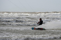 © Licensed to London News Pictures. 31/10/2020. Porthcawl, Bridgend, Wales, UK. Kite surfers make the best of the weather as gale force winds and massive waves batters the small Welsh seaside resort of Porthcawl in Bridgend, UK. Photo credit: Graham M. Lawrence/LNP