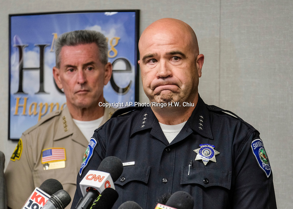 San Bernardino Police Department Chief Jarrod Burguan, right, in a media conference at Cajon High School, Monday, April 10, 2017, in San Bernardino, Calif., after a deadly shooting occurred at North Park Elementary School. (AP Photo/Ringo H.W. Chiu)