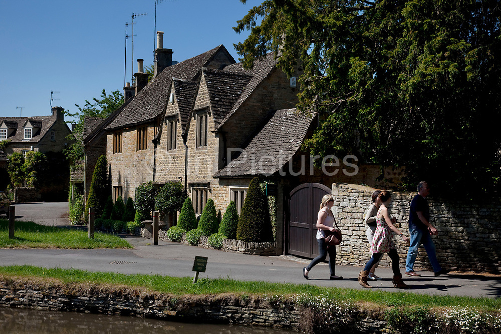 The wonderfully named Lower Slaughter in The Cotswolds, Gloucestershire, UK. The village is built on both banks of the River Eye, which also flows through Upper Slaughter. At the west end of the village there is an old water mill with an undershot waterwheel and a chimney for additional steam power. Popular with both the English themselves and international visitors from all over the world, the area is well known for gentle hillsides 'wolds', outstanding countryside, sleepy ancient limestone villages, historic market towns and for being so 'typically English' where time has stood still for over 300 years. Throughout the Cotswolds stone features in buildings and stone walls act as a common thread in seamlessly blending the historic towns & villages with their surrounding landscape. One of the most 'quintessentially English' and unspoiled regions of England.