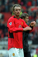 An upset looking David Beckham waves to the Old Trafford crowd for after possibly his final game for Manchester United. Manchester United v Charlton Athletic, FA Premiership, 3/05/2003. Credit: Colorsport / Matthew Impey