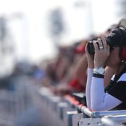 Race car spotters are seen on the newly build grandstand rooftop during the 58th Annual NASCAR Daytona 500 auto race at Daytona International Speedway on Sunday, February 21, 2016 in Daytona Beach, Florida.  (Alex Menendez via AP)