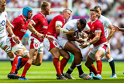 Joe Cokanasiga of England is tackled by Hadleigh Parkes and Josh Adams of Wales - Rogan/JMP - 11/08/2019 - RUGBY UNION - Twickenham Stadium - London, England - England v Wales - Quilter Series.