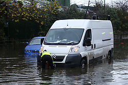 © Licensed to London News Pictures. 22/11/2016. Rotherham, UK. A man tries to free his van after getting stuck on a flooded road in Rotherham, South Yorkshire, after a river broke it's banks last night. Storm Angus has brought heavy wind and rain to much of the UK this week with flooding seen all over. Photo credit : Ian Hinchliffe/LNP
