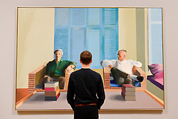 """© Licensed to London News Pictures. 06/02/2017. London, UK. A staff member views """"Christopher Isherwood and Don Bachardy"""" at the preview of the world's most extensive retrospective of the work of David Hockney at the Tate Britain, which will be on display 9 February to 29 May 2017. Photo credit : Stephen Chung/LNP"""