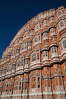 """Hawa Mahal  """"Palace of Winds"""" is a unique five storey building in Jaipur.  It's exterior has 953 windows decorated with intricate latticework  Hawa Mahal was built of sandstone and is a part of the City Palace.  Lal Chand Ustad was the architect of this unique masterpiece who also planned Jaipur city, much of which is built in pink colored sandstone. The Hawa Mahal is the symbol or icon of Jaipur """"The Pink City"""".  Jaipur is also the capital of Rajasthan."""