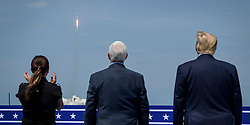 In this photo released by the National Aeronautics and Space Administration (NASA), President Donald Trump, right, Vice President Mike Pence, and Second Lady Karen Pence watch the launch of a SpaceX Falcon 9 rocket carrying the company's Crew Dragon spacecraft on NASA's SpaceX Demo-2 mission with NASA astronauts Robert Behnken and Douglas Hurley onboard, Saturday, May 30, 2020, from the balcony of Operations Support Building II at NASA's Kennedy Space Center in Florida. NASA's SpaceX Demo-2 mission is the first launch with astronauts of the SpaceX Crew Dragon spacecraft and Falcon 9 rocket to the International Space Station as part of the agency's Commercial Crew Program. The test flight serves as an end-to-end demonstration of SpaceX's crew transportation system. Behnken and Hurley launched at 3:22 p.m. EDT on Saturday, May 30, from Launch Complex 39A at the Kennedy Space Center. A new era of human spaceflight is set to begin as American astronauts once again launch on an American rocket from American soil to low-Earth orbit for the first time since the conclusion of the Space Shuttle Program in 2011. Photo by Bill Ingalls / NASA via CNP/ABACAPRESS.COM