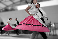 Selective colour image of folk dancers, Hajos, Hungary, photographed by Paul Williams