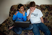 Ross Caputi, 27, (right) is researching on the internet with his wife, Dahlia Wasfi, 40, whose father is Iraqi, in their home in Lunenburg, near Boston, MA, USA, USA. Ross just completed a course in linguistics from Boston University. He was a radio operator for his company in Fallujah in 2004, during the battles. After leaving the Marines, he turned to anti-war activism. Ross runs a project called 'Justice for Fallujah', which aims at raising awareness about the problems in Fallujah since the 2004 US-led battles, and about the wrongs of war, after having witnessed them first-person as a soldier in Iraq.