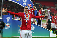 Zlatan Ibrahimovic of Manchester Utd celebrates with the trophy at the end of the game.  EFL Cup Final 2017, Manchester Utd v Southampton at Wembley Stadium in London on Sunday 26th February 2017. pic by Andrew Orchard, Andrew Orchard sports photography.