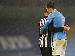 Dwight Gayle of Newcastle United (L) and John Stones of Manchester City at the final whistle - Mandatory by-line: Jack Phillips/JMP - 26/12/2020 - FOOTBALL - Etihad Stadium - Manchester, England - Manchester City v Newcastle United - English Premier League