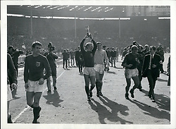 Jul. 07, 1966 - Football the 1966 World Cup. The Final England V. West Germany at Wembley Stadium. England won 4-2 after extra time.: Bobby Moore (England's Captain) leads his team around the Wembley Pitch after England's World Cup Final victory against West Germany. (Credit Image: © Keystone Press Agency/Keystone USA via ZUMAPRESS.com)