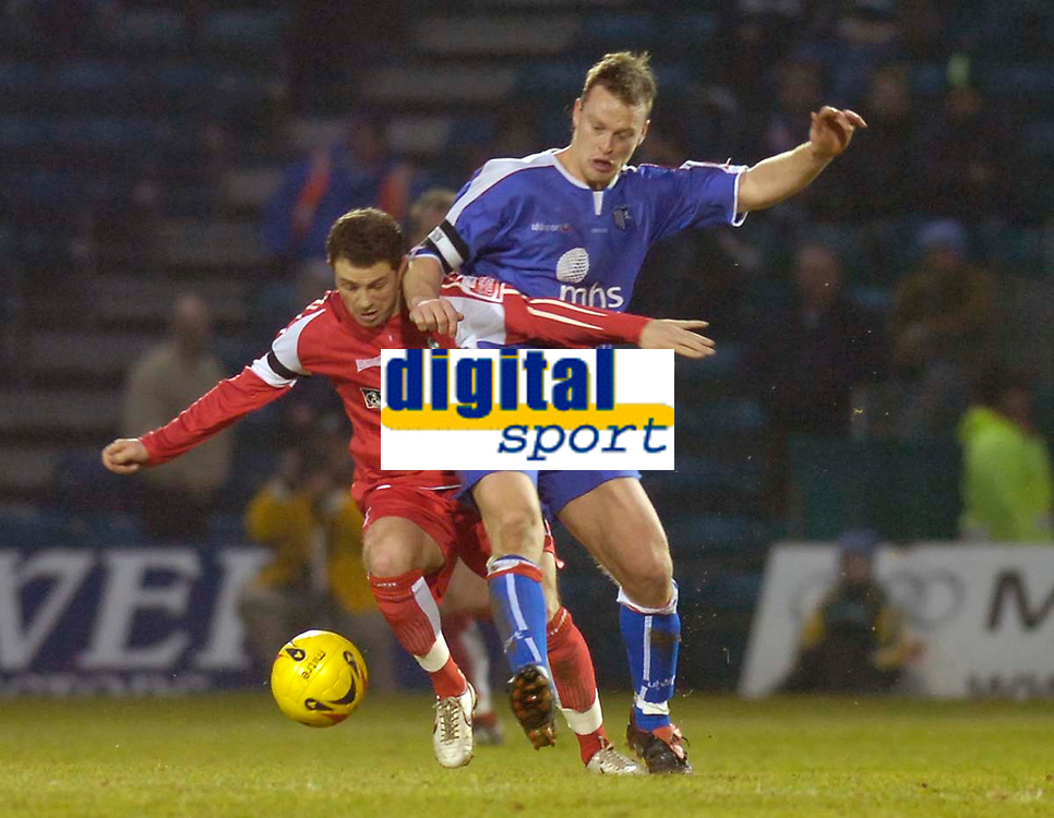 Photo: Alan Crowhurst.<br />Gillingham v Swindon Town. Coca Cola League 1. 14/01/2006. <br />Michael Flynn of Swindon (L) battles with Sean O'Hanlon.