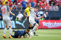 July 28, 2018 - Ann Arbor, Michigan, United States - Alexis Sanchez (7) of Manchester United and James Milner (7) of Liverpool collide during an International Champions Cup match between Manchester United and Liverpool at Michigan Stadium in Ann Arbor, Michigan USA, on Wednesday, July 28,  2018. (Credit Image: © Amy Lemus/NurPhoto via ZUMA Press)