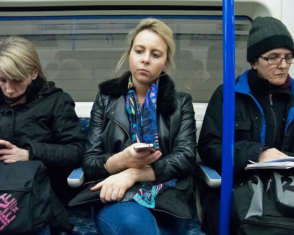 Portrait of women travelling on the London Underground Network