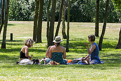 © Licensed to London News Pictures. 19/05/2020. London, UK. Members of the public relax in Finsbury Park, north London on a warm and sunny day in the capital. The government has relaxed the rules on the COVID-19 lockdown, allowing people to spend more time outdoors whilst following social distancing guidelines. According to the Met Office, 27 degrees celsius is forecast for tomorrow. Photo credit: Dinendra Haria/LNP