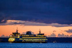 United States, Washington, Seattle, ferry on  Elliott Bay at sunset