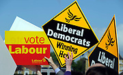 Placards for Labour and Liberal Democrtas on display during a visit by Nick Clegg, Leader of the Liberal Democrtas in South London.