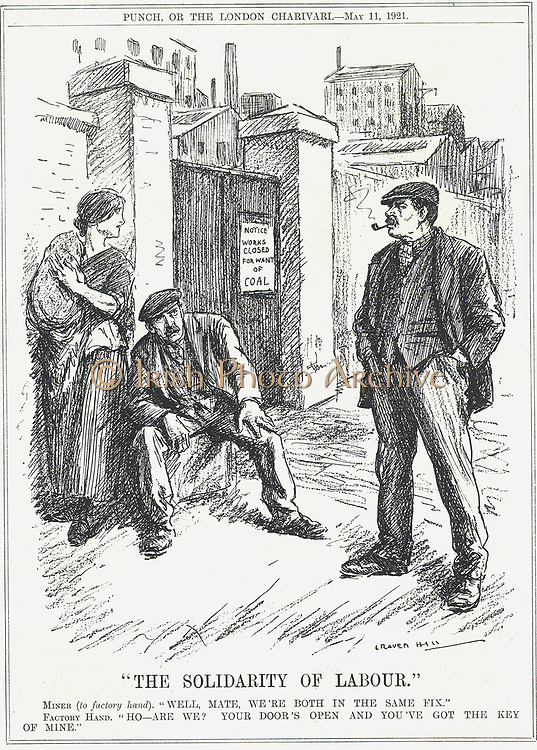 The Solidarity of Labour' : Factory worker, locked out because of lack of coal, telling a miner that he holds the key for all workplaces to open again.   Cartoon by  Leonard Raven-Hill, 11 May 1921.