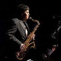 Jett Yazzie plays a tenor sax solo during Grants High School's Prism Concert Thursday, March 14 at the Grants High School Auditorium. Performers were positioned in different areas of the auditorium so the music comes from different sides and is continuous throughout the concert.