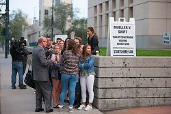 August 8, 2017 - Denver, Colorado, U.S - Swift fans and other people wait in line and take photos as they prepare to enter the courthouse for viewing the Taylor Swift Groping Trial against radio DJ David Mueller at the Alfred A. Arraj United States Courthouse in Denver, Colorado, U.S., on Tuesday, August 8, 2017. (Credit Image: © Matthew Staver via ZUMA Wire)