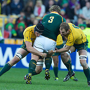 Jannie du Plessis, South Africa, is tackled by Dan Vickerman, (left) and Rocky Elsom, Australia, during the South Africa V Australia Quarter Final match at the IRB Rugby World Cup tournament. Wellington Regional Stadium, Wellington, New Zealand, 9th October 2011. Photo Tim Clayton...