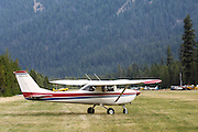 A couple from Germany came to America, purchased this Cessna 152, and were spending a year flying it around the United States and visiting various airshows and tourist areas. Here they are at Johnson Creek, Idaho grass field.