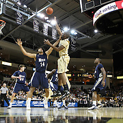 Central Florida forward Keith Clanton (33) shoots the ball against Arsalan Kazemi (14) of Iran during a Conference USA NCAA basketball game between the Rice Owls and the Central Florida Knights at the UCF Arena on January 22, 2011 in Orlando, Florida. Rice won the game 57-50 and extended the Knights losing streak to 4 games.  (AP Photo/Alex Menendez)