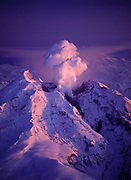 Aerial view of sunset light illuminating the dome-building eruption of Redoubt Volcano on April 20, 2009, Lake Clark National Park, Alaska.