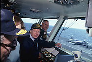 President Carter on the flight control center of the carrier USS Dwight  Eisenhower  in March 1978, Rosalynn Carter and Secretary of Defense Harold Brown  are to Carter's right.<br /> Photo by Dennis Brack