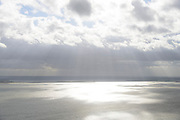 Nederland, Zuid-Holland, Voorne-Putten, 23-10-2013;  zon breekt door de wolken en verlicht de zee ter hoogte van Rockanje, Haringvlietdam en Goeree-Overflakkee in de verte.<br /> Sun breaks through the clouds and illuminates the sea, Island of South Holland.ag op standard tarieven);<br /> aerial photo (additional fee required);<br /> copyright foto/photo Siebe Swart
