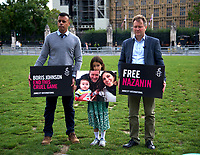 Amnesty UK CEO Sacha Deshmukh Richard Ratcliffe,Gabriella Radcliffe At the  photocall the  took place in Parliament Square to mark Nazanin Zaghari-Ratcliffe's 2000th day of being detained in Iran, A giant snakes and ladders board was used to show the ups and downs of Nazanin's case photo by Leigh Bruin