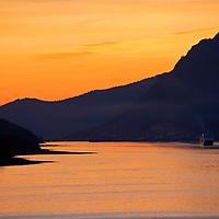 North America, USA, Alaska. Sunset colors of the Alaskan Inside passage.