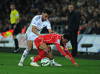 Liverpool's Raheem Sterling is fouled by Swansea City's Neil Taylor<br /> <br /> Photographer Kevin Barnes/CameraSport<br /> <br /> Football - Barclays Premiership - Swansea City v Liverpool - Monday 16th March - The Liberty Stadium - Swansea<br /> <br /> © CameraSport - 43 Linden Ave. Countesthorpe. Leicester. England. LE8 5PG - Tel: +44 (0) 116 277 4147 - admin@camerasport.com - www.camerasport.com